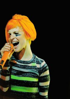 Hayley Williams #outfit -neon green undershirt, sheer striped sweater