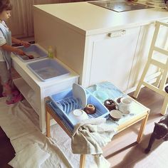 Montessori kitchen with washing up station so your child can help with washing dishes.