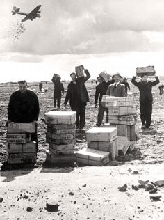 Food is dropped at Schiphol Airport, Amsterdam, May 1945. KRYN TACONIS, LIBRARY AND ARCHIVES CANADA—PA164611
