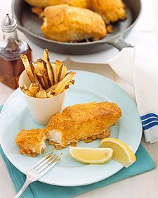 Traditional fish and chips is updated to highlight the delicate flavor of the fillet, which is often overwhelmed by heavy fried batters. Baking the potato slices with just a hint of olive oil produces flavorful, perfectly crisp yet low-fat chips.