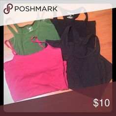 "Basic tank top lot Set of 4 tank tops. 2 black racerbacks, one strappy maroon (has built in ""bra"") and one basic green. Ask for more details or make an offer, willing to split up the set if you need. Tops Tank Tops"