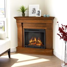 Simply plug in Real Flame Espresso Chateau Corner Electric Fireplace, sit back, and enjoy the cozy comfort of a no-maintenance fireplace. Love how its in a corner!