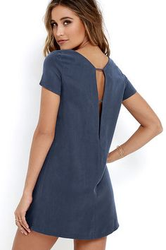 Take a mini vacation every time you slip on the Mumbai the Way Washed Blue Shift Dress! Soft and sleek woven fabric shapes short sleeves, rounded neckline, and straight-cut bodice with darting. The effortlessly cool silhouette gets a sultry peek of skin at back, thanks to a strappy V cutout.