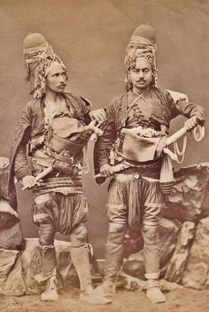 Portrait of two 'Efe / Zeybek' (the local 18th-19th century people's militia from the Aegean region), who sometimes turned themselves into professional brigands, or joined the Ottoman army as 'başıbozuk' (mercenary, or irregular soldier).  The photograph dates from the late 19th century.