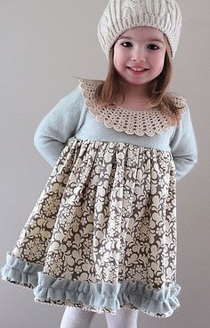 such a great idea--use an adult sweater cut down as a dress! =)