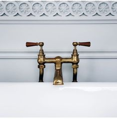 Timeless brass bathtub faucet • The Ned, London