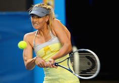 Maria Sharapova of Russia plays a backhand in her third round match against Venus Williams of the United States during day five of the 2013 Australian Open at Melbourne Park on January 18, 2013 in Melbourne, Australia.