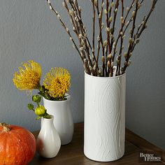 Vases branch out from flat-finish to raised-ridges using some puff paint. It's a cinch: Freehand-doodle wood-grain patterns onto your vase with a bottle of puff paint. Let dry, then go over the design with same-color spray paint.   /