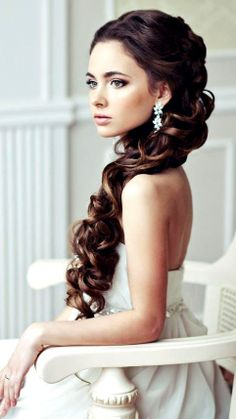 Bride's half up long curls and those earrings!!! So beautiful