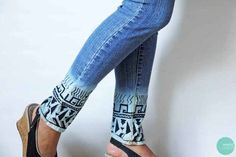Bleach the bottom of your jeans and use a sharpie to create a tribal pattern.