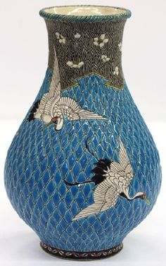 This Aesthetic Movement polychrome decorated vase, circa 1880, features a bulbous form having an incised and polychrome decorated surface depicting birds in flight, executed in the Anglo Japanese taste and having a floral decorated neck.