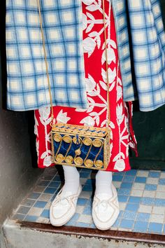 What came first: the tiles or the coat