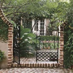 NOTE- Stucco material with brick garden wall.  Court Gate in Charleston