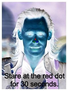 Stare at the red dot and then look at your wall or a piece of white paper.
