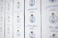 blue and white nautical escort cards | photo: Michelle Turner Photography