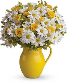 Pitcher of daisies and roses