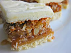 Passion Cookies.  Crumbly, shortbread base with gooey, pecan pie-like filling topped with swirls of vanilla frosting.