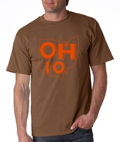 Our Ohio T-Shirt - Cleveland Edition is for lean and hungry champions only. Sure, it's been a while since the good old glory days of yore, but that doesn't mean the heart of a proud Cleveland fan doesn't beat beneath this orange on brown or brown on orange beauty.  Let the haters keep on hating, but you should stand tall knowing it's just a matter of time before brown becomes the new gold.