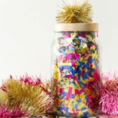 Hide gifts in these confetti jars for a fun surprise at a secret Santa or grab bag exchange!