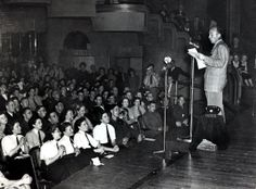 27th August 1940: Bing Crosby singing for members of the services at the Queensbury Club, London ~