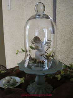 Blossom~by~blossom Spring evolves On Crooked Creek. This past week, I was on the hunt for a small natural element wreath. Glass Domes, Glass Jars, Christmas Crafts, Christmas Decorations, Table Decorations, Cloche Decor, Willow Tree Angels, Willow Tree Figurines, Shabby Chic Stil