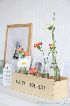 Beautiful flowers. love the use of old bottles
