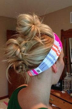 Headbands are probably already a part of your regular gym hair routine, but you can make them go the extra mile by using them to accent your go-to gym hairstyle. This knotted fauxhawk is kept in place thanks to a bold, striped headband.