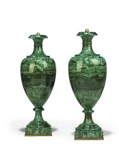 A PAIR OF RUSSIAN MALACHITE-VENEERED VASES  FIRST HALF 19TH CENTURY  Each with tapering ovoid body surmounted by a waisted neck and outscrolled rim, above a waisted socle and circular spreading foot with square stepped plinth,   22½ in. (57 cm.) high (2)