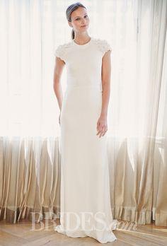 Modest short sleeve sheath gown with floral appliques. Brides.com: Celestina Agostino - Spring 2015. Wedding dress by Celestina Agostino