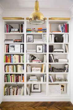 Fantastic light & airy shelving for books - I need a wall of books in my life!!