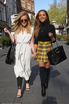 Close friends: She held hands with fellow band member Perrie Edwards as they made their wa...