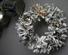 This is one of the nicer-looking wreaths that I've come across that's made out of newspaper. #DIY fun! (made by Camilla Fabbri: http://cfabbridesigns.com/holidays/christmas/all-the-news-thats-fit-to-primp/)
