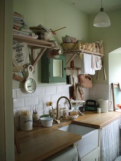 vintage kitchen ... just like farm-style sink & open style:  curtains coming down from counter, shelves & mirror cabinet