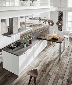 #Kitchen Lux Classic with Arctic White matt lacquer shaker doors. Lumina island extractor with integrated lighting. Breakfast bar in Smoke Oak. cucine classiche #classickitchens #cucineconisola #islandkitchens #Snaidero