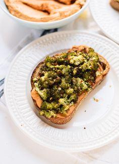 Roasted broccoli crostini with sun-dried tomato hummus - cookieandkate.com