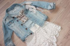 Sequin bustier, white lace shorts, and a light wash denim jacket. CUTE!