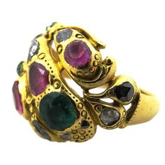 Early Anglo-Indian snake ring with emeralds, rubies, pink sapphires, and natural black (rare to find in antique jewelry, as most black diamonds today are heat treated) and white diamonds in 18kt gold setting, circa 1860