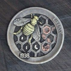 ~ Beautiful Bees ~ Carved by Simone Cervellati on a 1936 Buffalo Nickel. A depiction of the stages of the life of a bee, this coin has several inlays, Brass for the bee, copper for the cell caps and silver for the larvae. The coin is signed and dated on the back with my initials and the year.