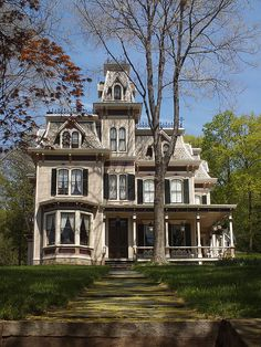 Second Empire style victorian in Mount Kisco, NY. Second Empire style has a high mansard roof and is inspired by the architecture in Paris during the reign of Napoleon III.