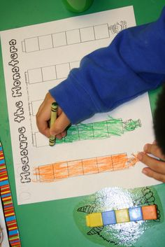 Mrs. Lee's Kindergarten: Monster Centers and Monster Fun! Measure cut-outs with unifix, color how tall each was on recording sheet.