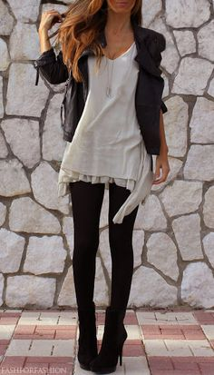 oatmeal sharkbite long tank with ruffles underneath, leather jacket, black tights and black booties