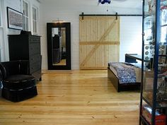 BARN DOOR - This door sets the stage for a super cool closet to be on the other side!