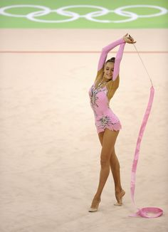 Russia's gymnast Evgeniya Kanaeva performs with the ribbon during the gymnastics rhythmic individual all-around qualification at the Beijing 2008 Olympics