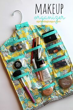 How to make a hanging makeup organzier from A girl and a glue gun #tutorial #makeup #upcycle