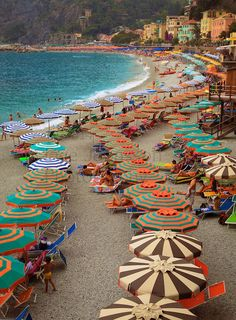 Umbrellas on the beach of Monterosso, one of the five towns in Italy's Cinque Terre