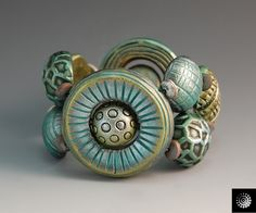 Bracelet by Bettina Welker, carved and tinted.