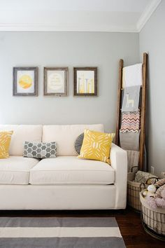 Yellow and grey nursery décor.. loving the recycled timber frames