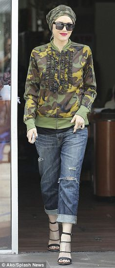 Post-baby slim: The 44-year-old super megatar singer Gwen Stefani displayed a remarkably slender figure in her army green jacket and jeans as she strolled to her nail appointment