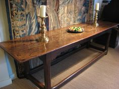 """17TH CENTURY OAK REFECTORY TABLE.    OF EXCEPTIONAL COLOUR AND PATINATION. THE THREE PLANKED TOP ABOVE A BASE WITH FOUR SQUARE FACETED LEGS, UNITED BY STRETCHERS.EXCELLENT CONDITION.  9FT 1"""" LONG  29.5"""" WIDE  30"""" HIGH."""