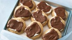 Top graham cracker cookies with marshmallows and chocolate to make s'mores any time of year!